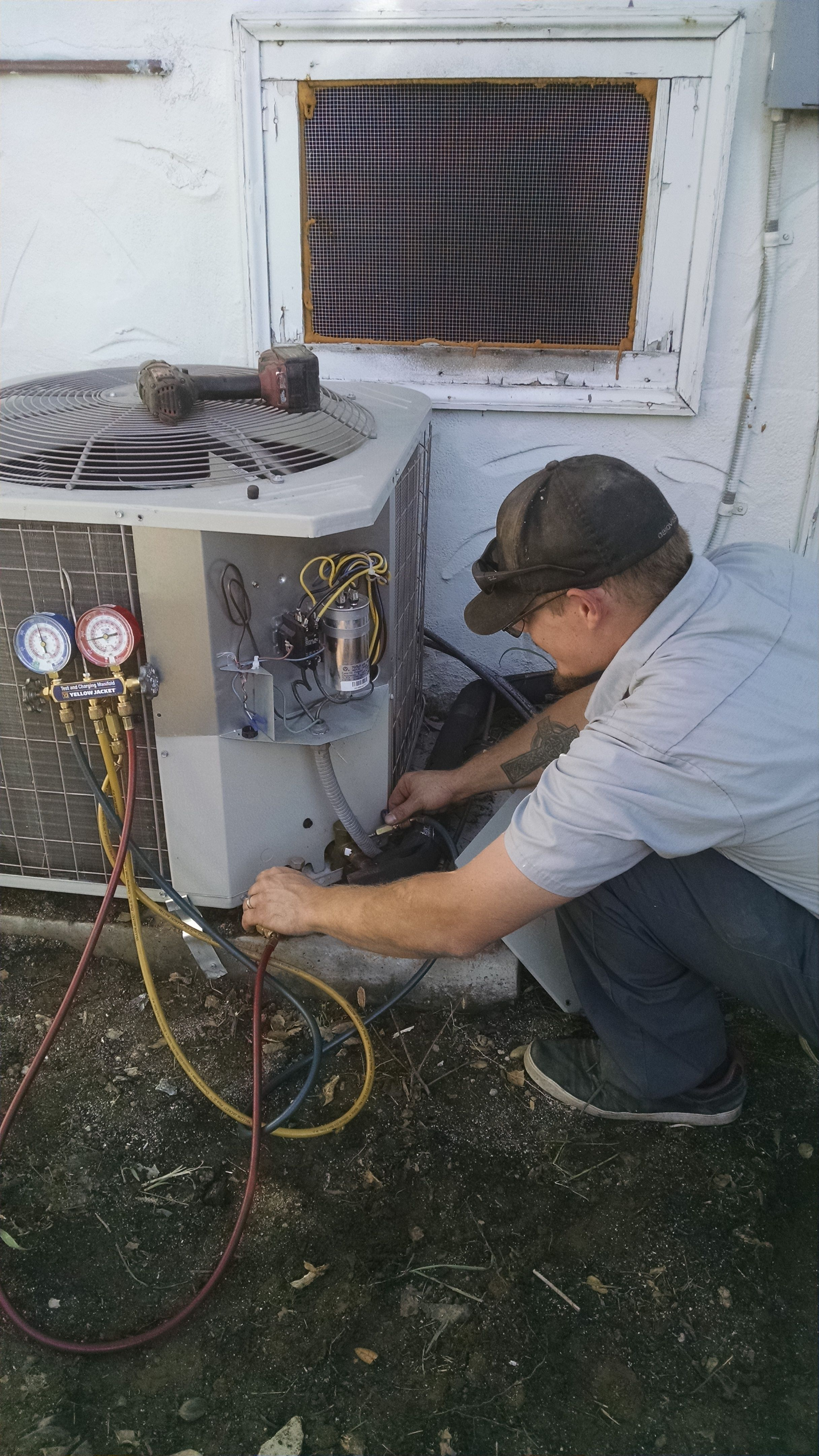 ATC technician performing an AC repair